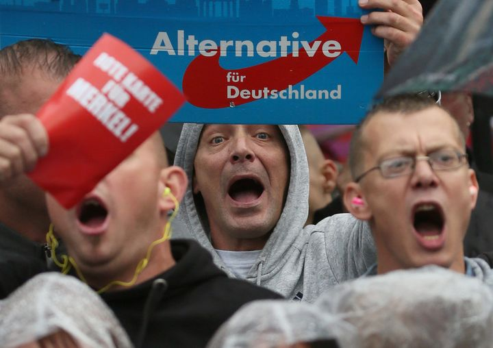 Supporters of the hard-right Alternative for Germany (AfD) party shout slogans during an election campaign rally of German Ch