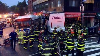 A New York City transit bus and a Dahlia tour bus collided, spinning around before slamming into a building in the city's borough of Queens, New York, U.S., September 18, 2017.   FDNY/Handout via REUTERS    ATTENTION EDITORS - THIS IMAGE WAS PROVIDED BY A THIRD PARTY.  MANDATORY CREDIT.?