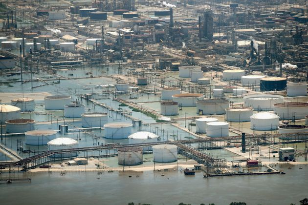 Floodwaters left in the wake of Hurricane Harvey begin to recede in an industrial area on Aug. 31, 2017,...