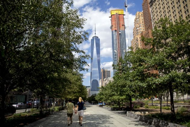 People walk along the Hudson River Greenway in New York City, Aug. 26,