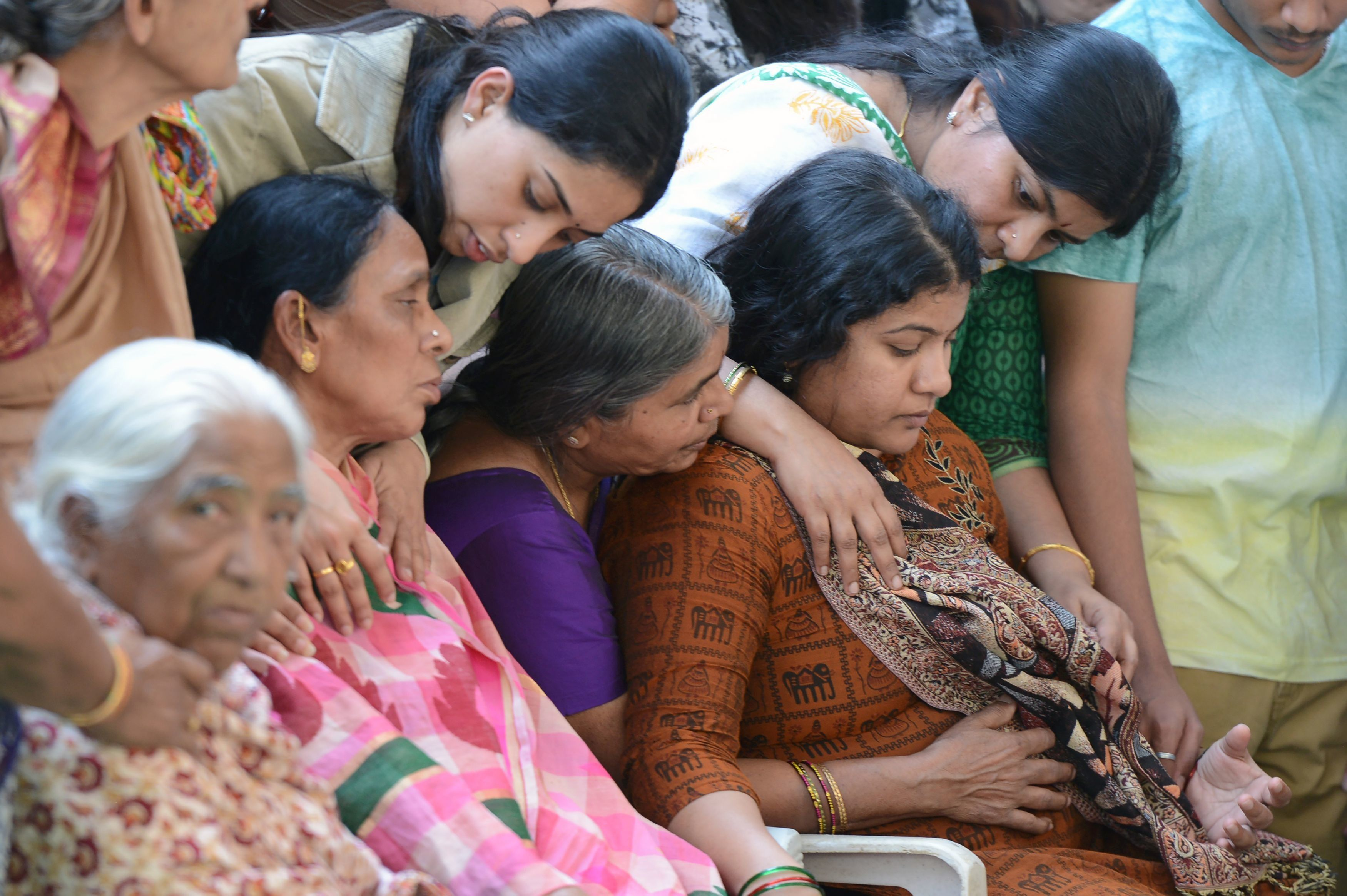 Sunayana Dumala (R), wife of killed Indian engineer Srinivas Kuchibhotla, who was shot dead in the US state of Kansas, is con