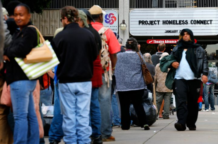 Homeless families and individuals line up to attend Project Homeless Connect in San Diego in 2015, a one-day resource fair. L
