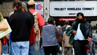 A long line of homeless families and individuals line up to attend Project Homeless Connect in San Diego, California January 28, 2015. Project Homeless connect is a one-day resource fair of 400 volunteers and 90 service providers that provides services to homeless individuals and families in San Diego. REUTERS/Mike Blake  (UNITED STATES - Tags: SOCIETY HEALTH POLITICS POVERTY)