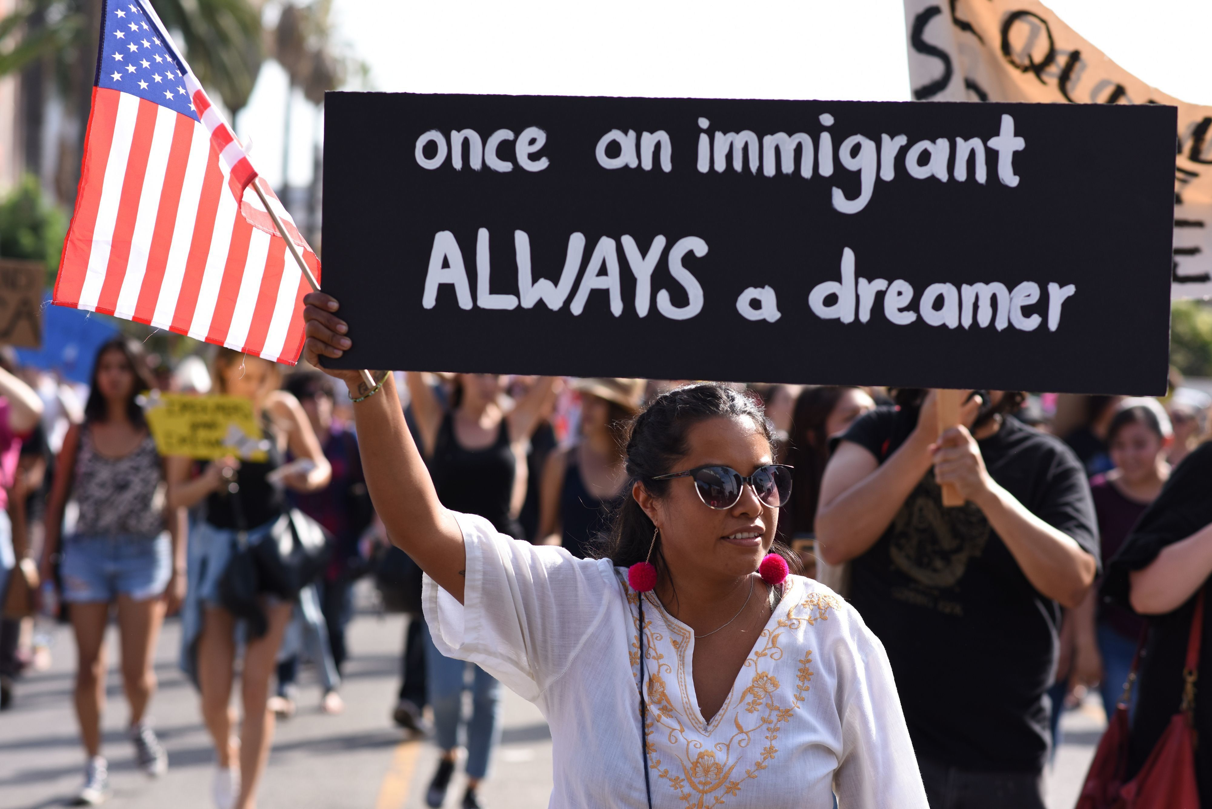 People protest efforts by the Trump administration to phase out DACA (Deferred Action for Childhood Arrivals) which provides protection from deportation for young immigrants brought into the US illegally by their parents, September 10, 2017 in Los Angeles, California. / AFP PHOTO / Robyn Beck        (Photo credit should read ROBYN BECK/AFP/Getty Images)