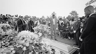 (Original Caption) Birmingham, Alabama: Graveside services at Woodlawn cemetery as body of Cynthia Dianne Wesley was buried. Officiating ministers are at left; family at right. Moments later, similar services were held at another grave nearby for Addie Mae Collins. Both girls were victims of the 9/15/1963 bombing of a Negro church.