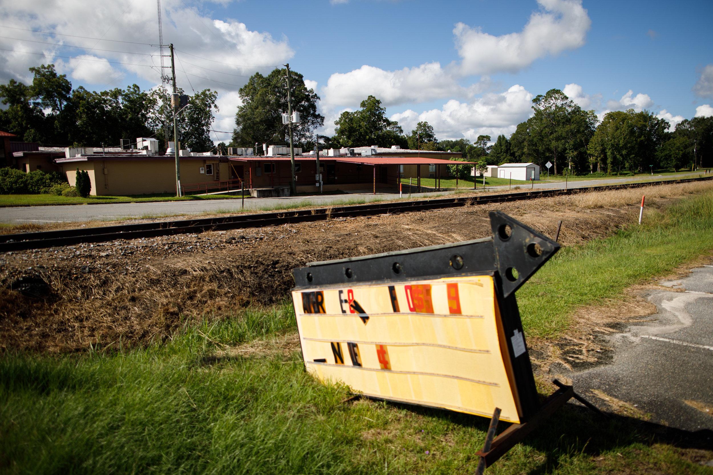 Recently shuttered Lower Oconee Community Hospital seen across train tracks in Glenwood, GA.
