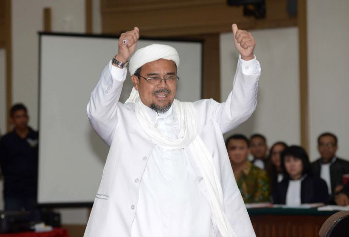 Rizieq Shihab, the head of Islamic Defenders Front, arrives in court to testify in Purnama's blasphemy trial. Feb. 28.