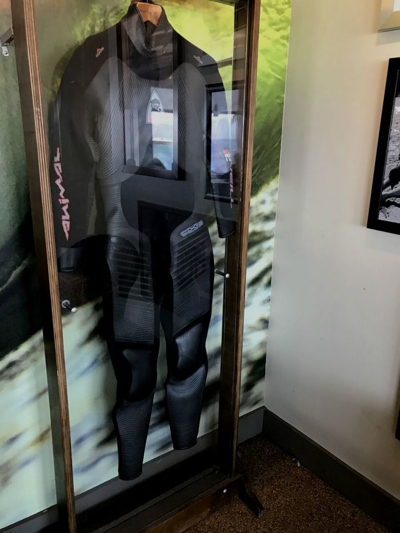 An original O'Neill wetsuit on display at Jack O'Neill Lounge