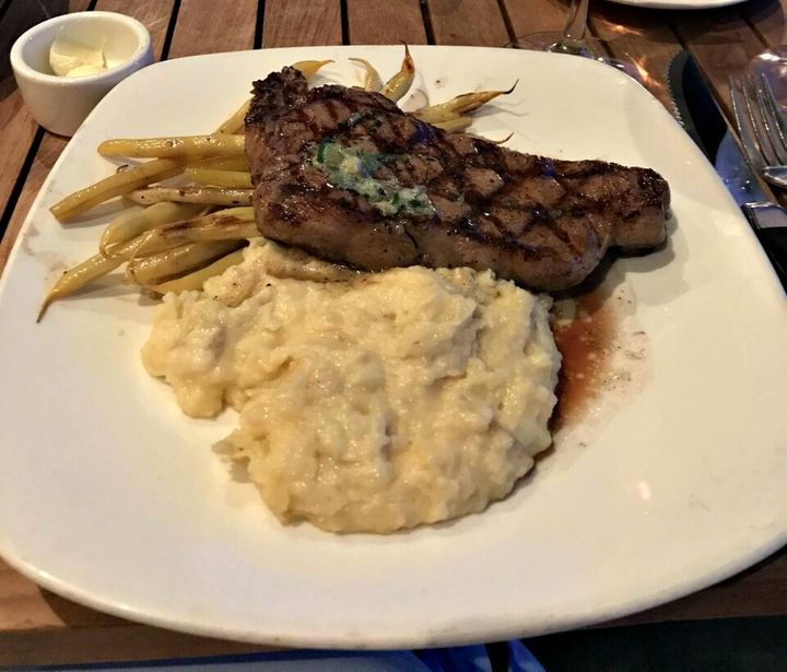 <p>Grilled Steak with Mashed Potatoes and seasonal vegetables</p>