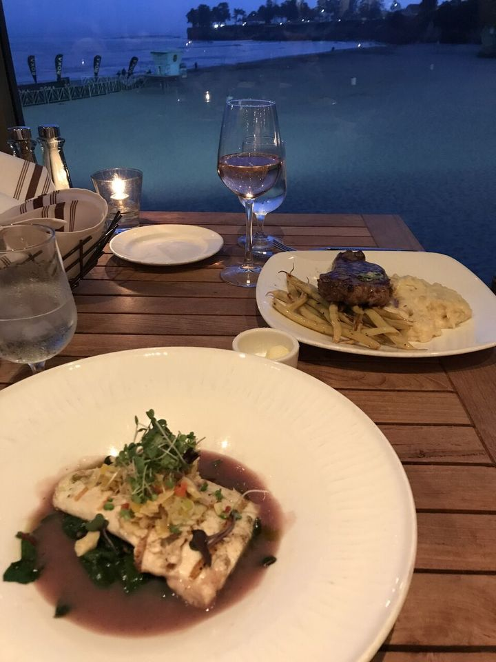 <p>Grilled Halibut with castroville artichoke salsa, braised greens and burgundy fumé. </p>