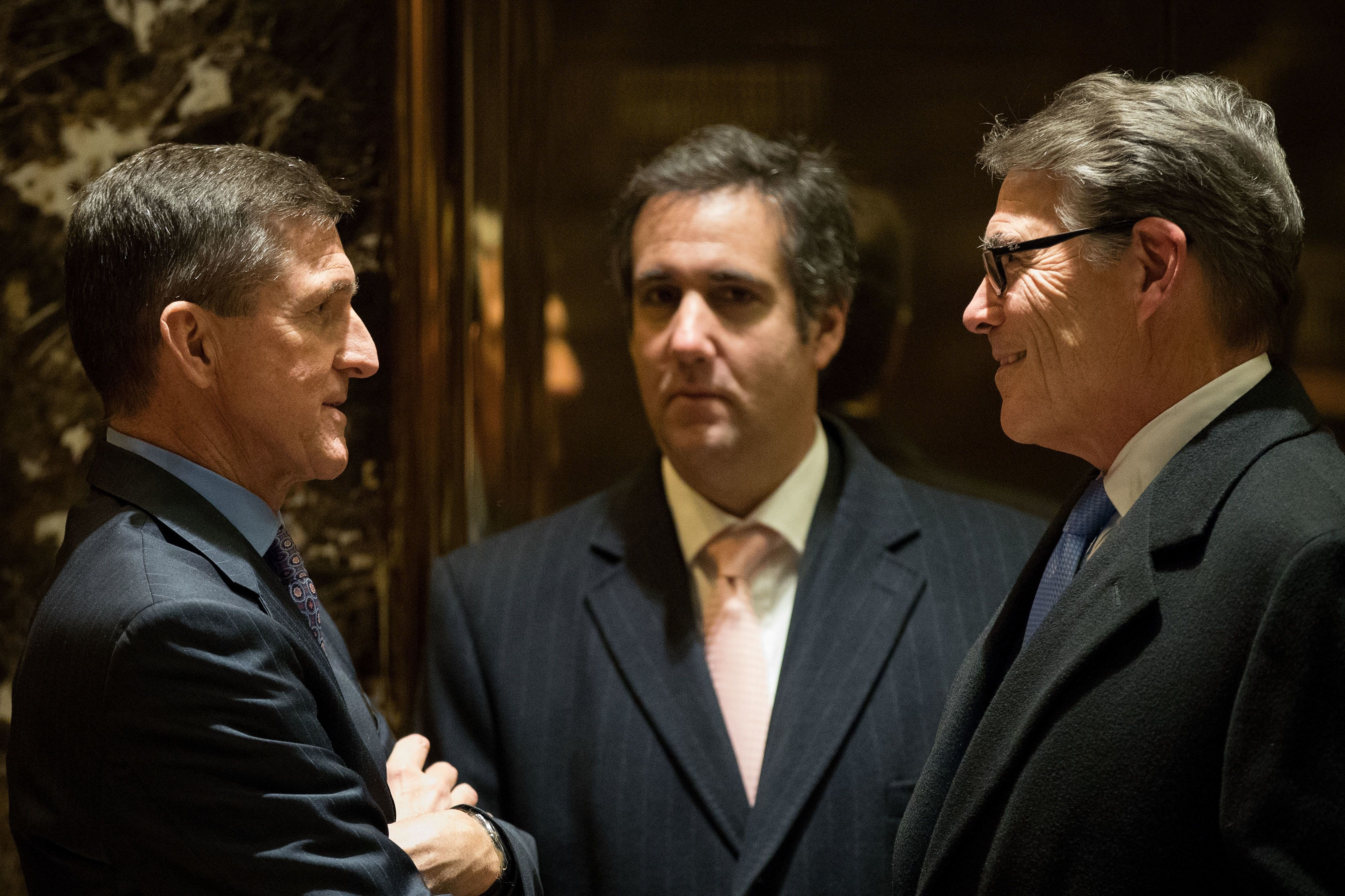 NEW YORK, NY - DECEMBER 12: (L to R) Retired Lt. Gen. Michael Flynn, President-elect Donald Trump's choice for National Security Advisor, Michael Cohen, executive vice president of the Trump Organization and special counsel to Donald Trump, and former Texas Governor Rick Perry talk with each other in the lobby at Trump Tower, December 12, 2016 in New York City. President-elect Donald Trump and his transition team are in the process of filling cabinet and other high level positions for the new administration. (Photo by Drew Angerer/Getty Images)