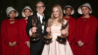 LOS ANGELES, CA - SEPTEMBER 17:  Executive Producer Warren Littlefield winner Outstanding Drama Series for 'The Handmaid's Tale' and Elisabeth Moss, winner of the awards for Outstanding Drama Series and Outstanding Lead Actress in a Drama Series for 'The Handmaid's Tale' attends Hulu's 2017 Emmy After Party at Otium on September 17, 2017 in Los Angeles, California.  (Photo by Todd Williamson/Getty Images for Hulu)