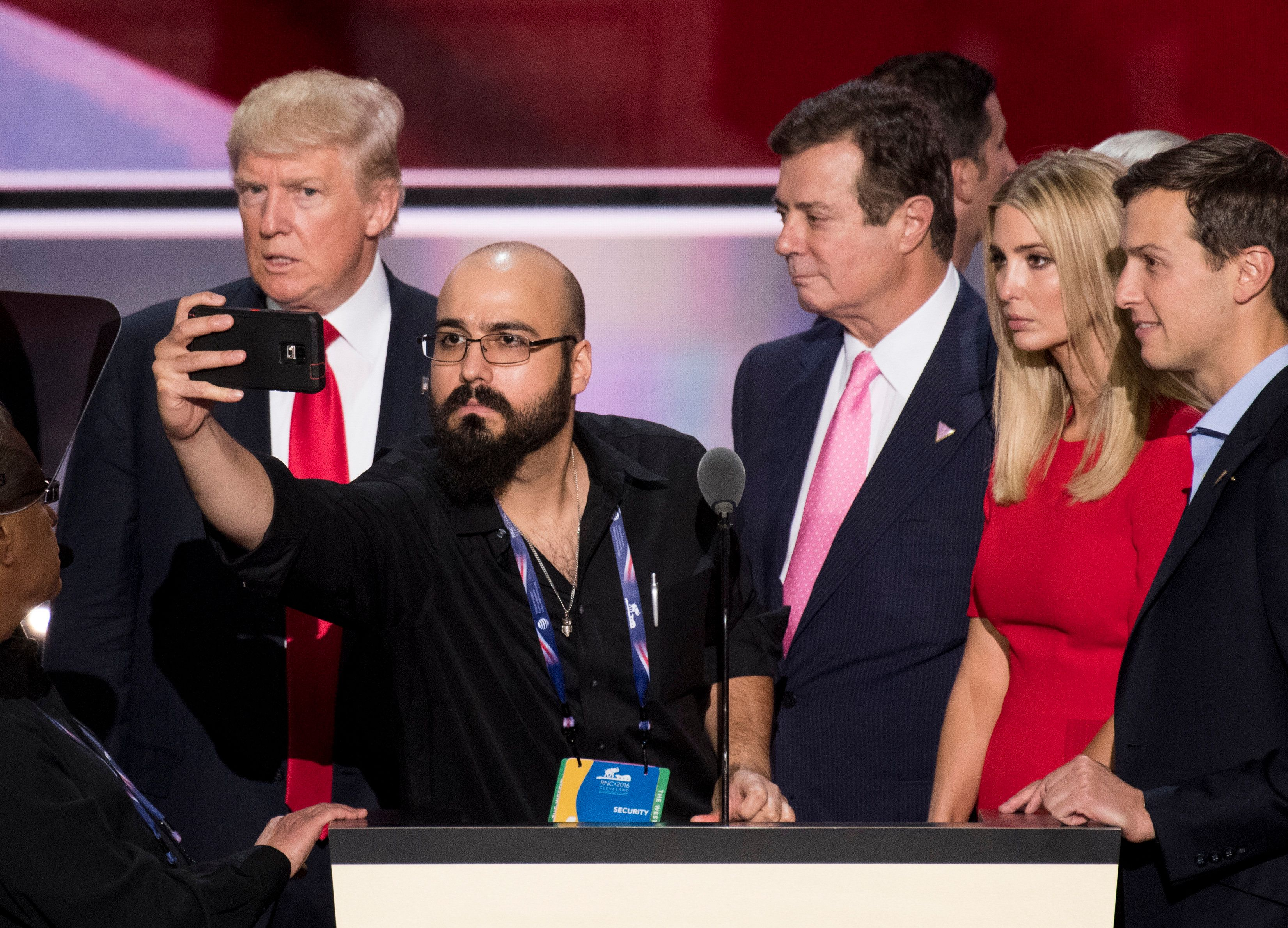 Donald Trump, flanked by campaign manager Paul Manafort (3rd from right) and daughter Ivanka inJuly