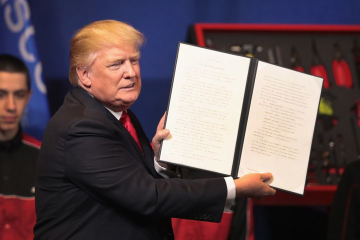 President Donald Trump signs an executive order to try to bring jobs back to American workers and revamp the H-1B visa guest