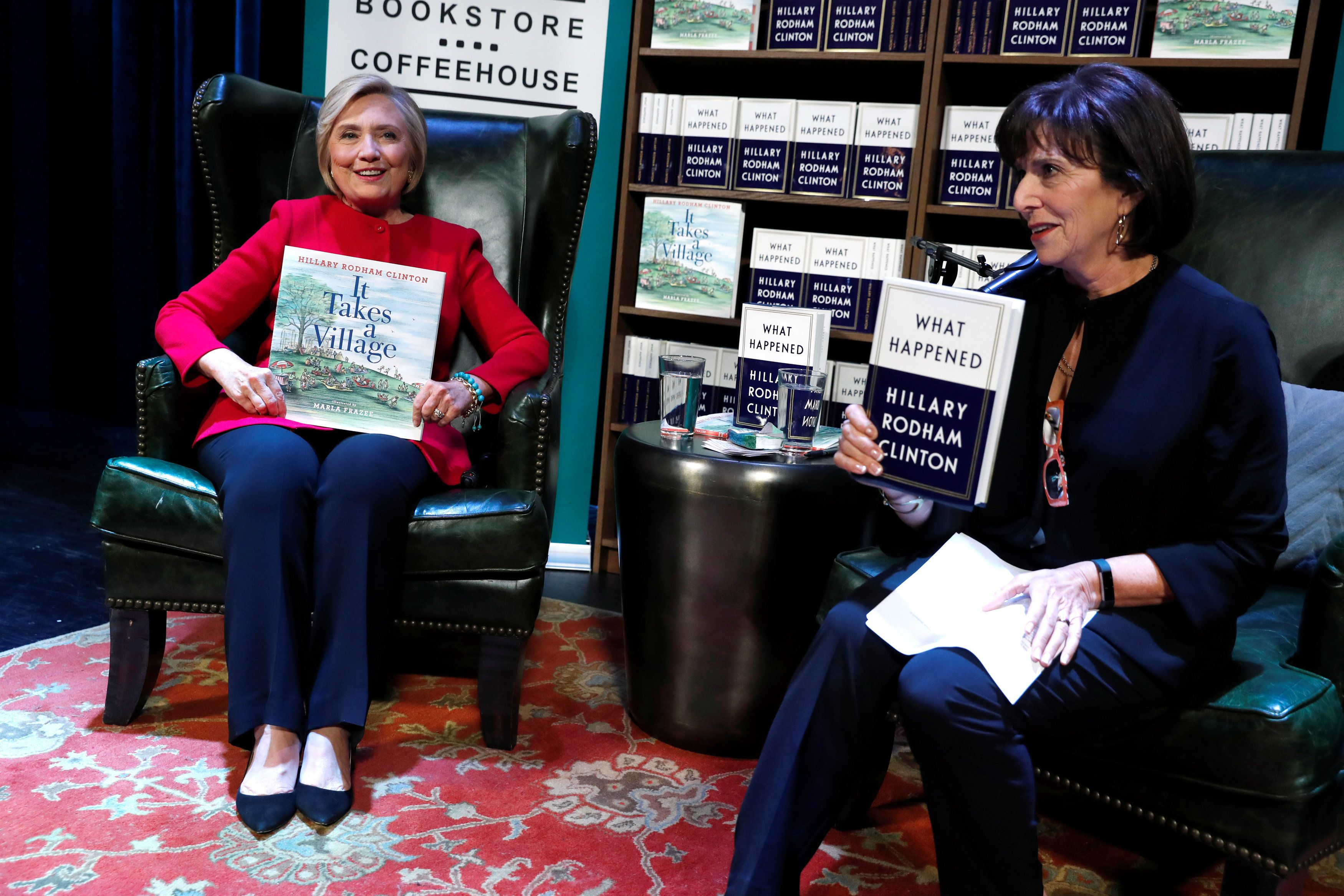 """Former U.S. Secretary of State Hillary Clinton (L), with bookstore owner Lissa Muscatine (R), takes the stage to discuss her new book """"What Happened"""" as she launches a 15-city book tour at the Warner Theatre in Washington, U.S. September 18, 2017. REUTERS/Jonathan Ernst"""