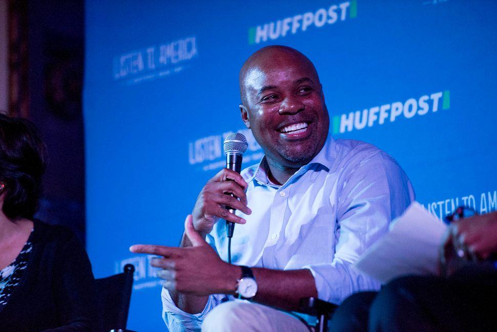 Floyd Tyler jokes with other panelists.