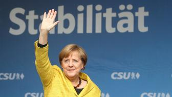 German Chancellor Angela Merkel, top candidate of the Christian Democratic Union Party (CDU) for the upcoming general elections, waves to supporters during an election rally in Regensburg, Germany, September 18, 2017.    REUTERS/Michael Dalder