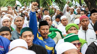 JAKARTA, INDONESIA - OCTOBER 14: Indonesian members of hardline group Front Pembela Islam (FPI) or Islamic Defenders Front hold a roll call in a protest against, Governor of Jakarta, Basuki T Purnama on October 14, 2016 in Jakarta, Indonesia.   PHOTOGRAPH BY Jefta Images / Barcroft Images  London-T:+44 207 033 1031 E:hello@barcroftmedia.com - New York-T:+1 212 796 2458 E:hello@barcroftusa.com - New Delhi-T:+91 11 4053 2429 E:hello@barcroftindia.com www.barcroftimages.com (Photo credit should read Jefta Images / Barcroft Images / Barcroft Media via Getty Images)