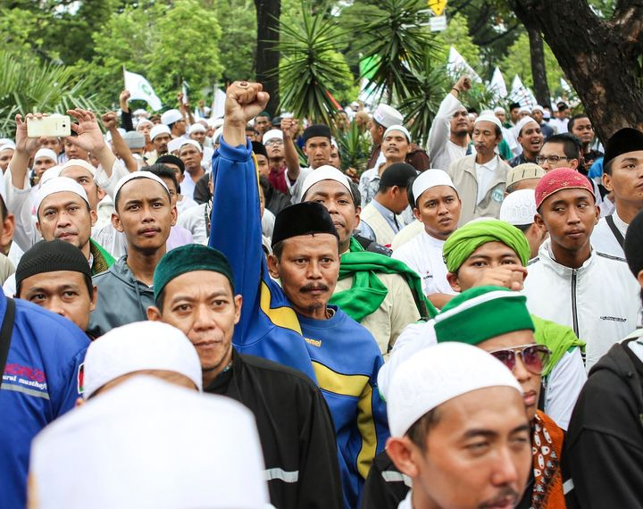 Indonesian members of Islamic Defenders Front, a hard-line Islamist group, at a protest against Basuki Tjahaja