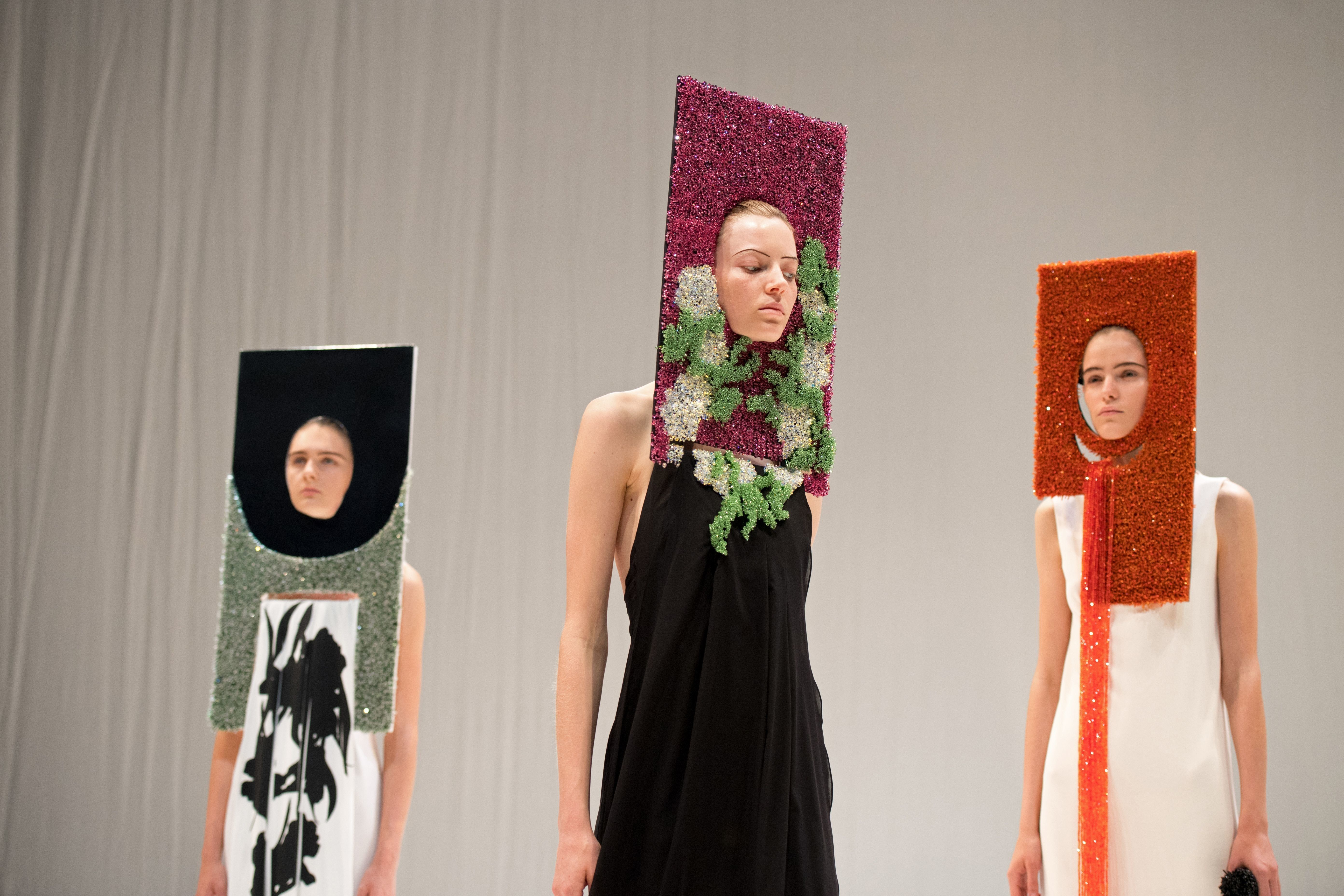 Models present creations by British designer Hussein Chalayan during his catwalkatLondon Fashion Week on Sept. 17.