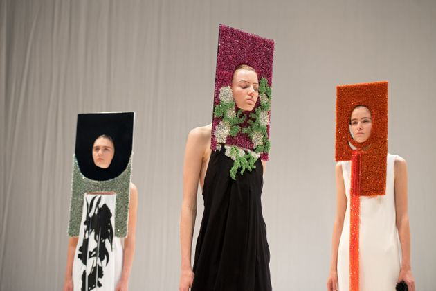 Models present creations by British designer Hussein Chalayan during his catwalk at London...