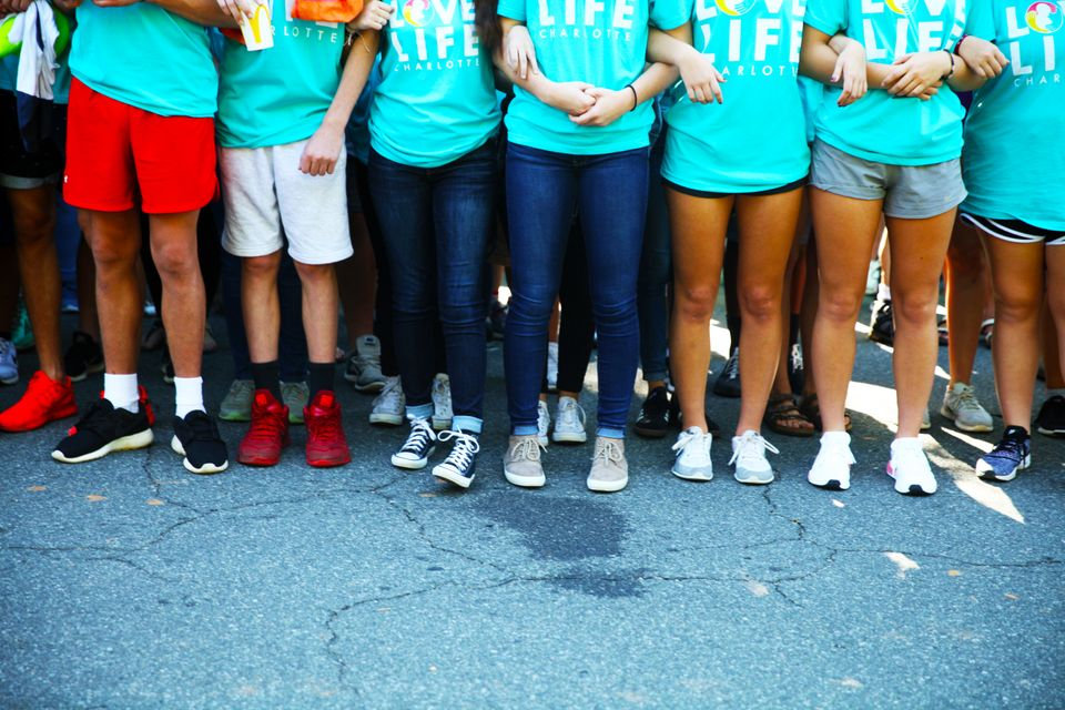 Kids link arms outside A Preferred Women's Health Center in Charlotte to protest abortion