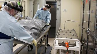 Men transfer the body of a suspected opioid overdose at ForensicDx, a company which specializes in autopsies and scientific testing, in Windber, Pennsylvania, U.S. on August 9, 2017.  Picture taken on August 9, 2017. REUTERS/Adrees Latif
