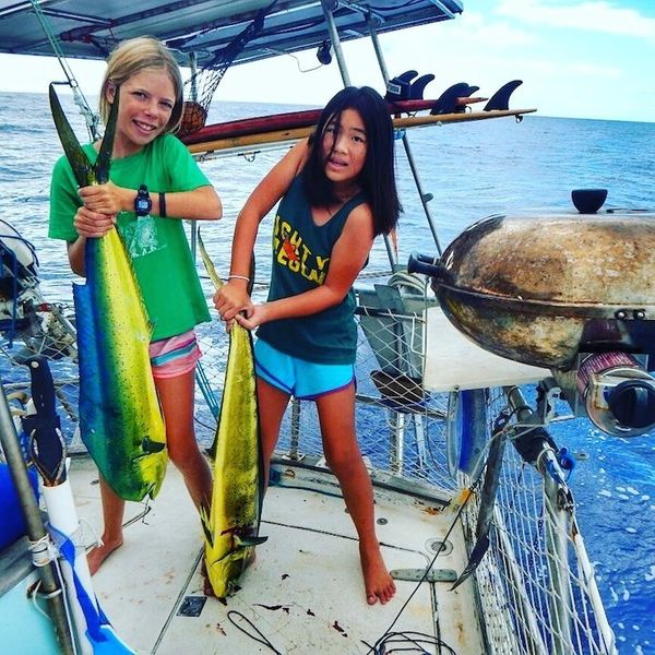 """""""We are a family of four who live on a sailboat currently in the South Pacific. Our daughters know more about how to fish tha"""