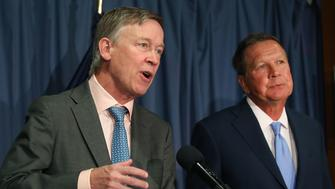 WASHINGTON, DC - JUNE 27: Gov. John Hickenlooper (D-CO) (L) and Gov. John Kasich, (R-OH) participate in a bipartisan news conference to discuss the Senate health care reform bill at the National Press Club on June 27, 2017 in Washington, DC. The governors called on Senate Democrats and Republicans to work together to come up with a better health care bill. (Photo by Mark Wilson/Getty Images)