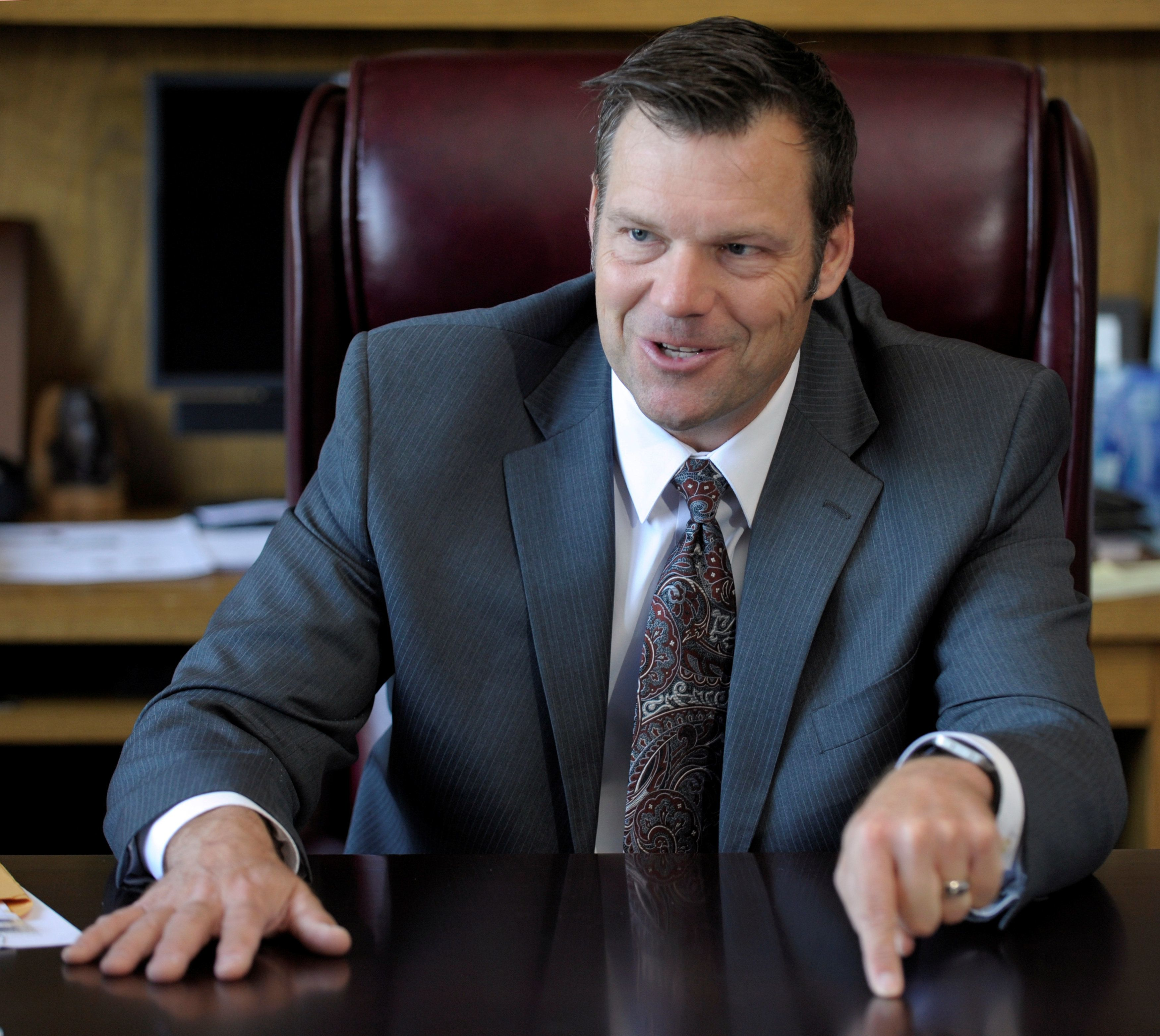 Kansas Secretary of State Kris Kobach talks about the Kansas voter ID law that he pushed to combat what he believes to be rampant voter fraud in the United States in his Topeka, Kansas, U.S., office May 12, 2016. REUTERS/Dave Kaup TPX IMAGES OF THE DAY