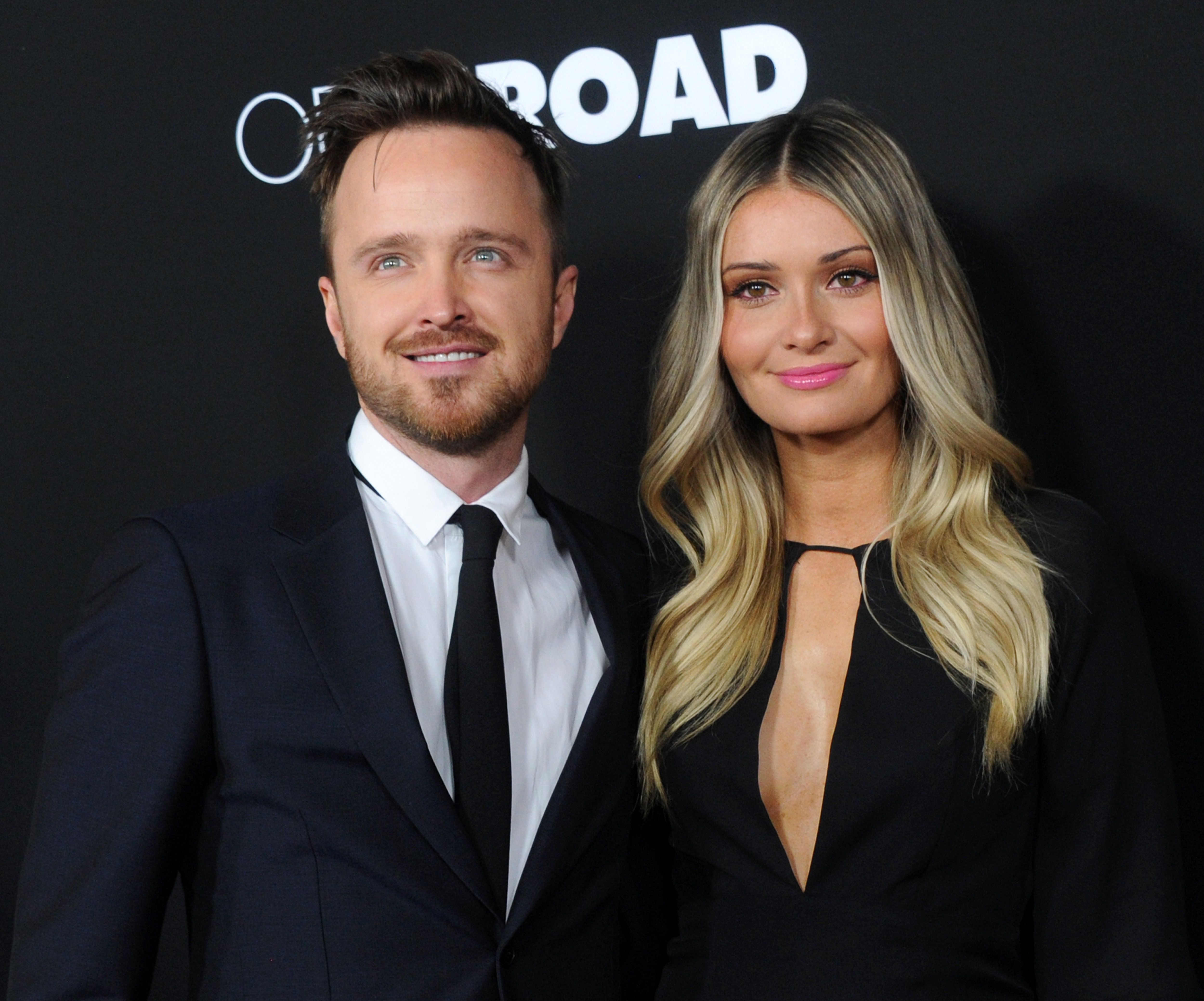 LOS ANGELES, CA - FEBRUARY 16:  Actor Aaron Paul and wife Lauren Parsekian arrive at the premiere of Open Road's 'Triple 9' at Regal Cinemas L.A. Live on February 16, 2016 in Los Angeles, California.  (Photo by Gregg DeGuire/WireImage)