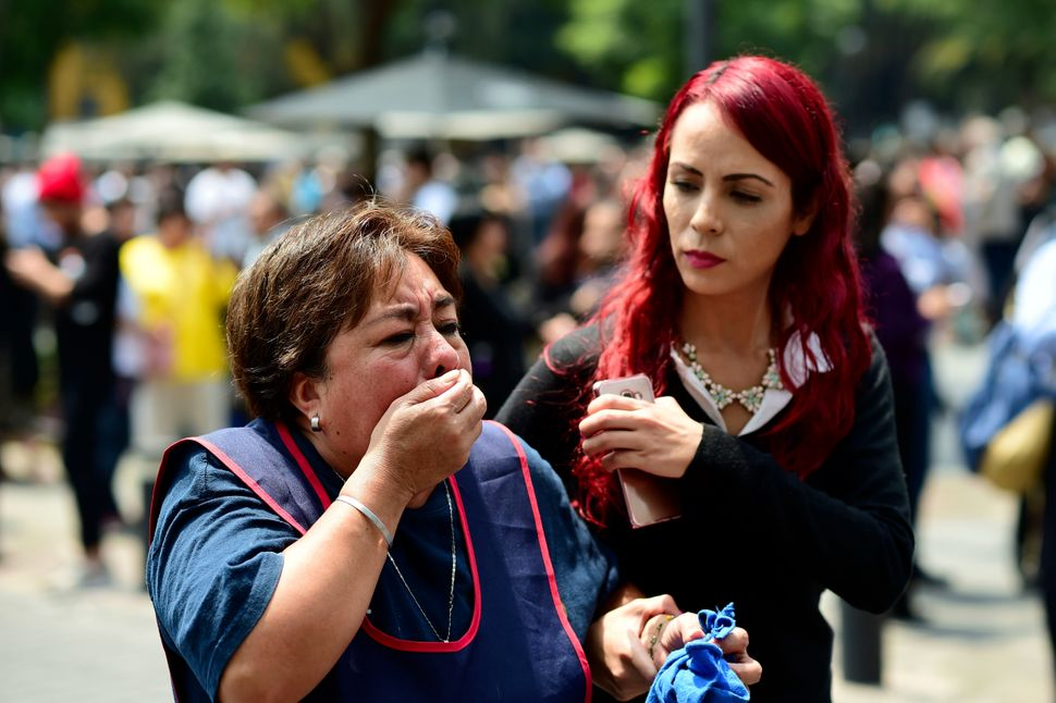 A woman reacts as a real quake rattles Mexico City on Tuesday as an earthquake drill was being held in the capital.