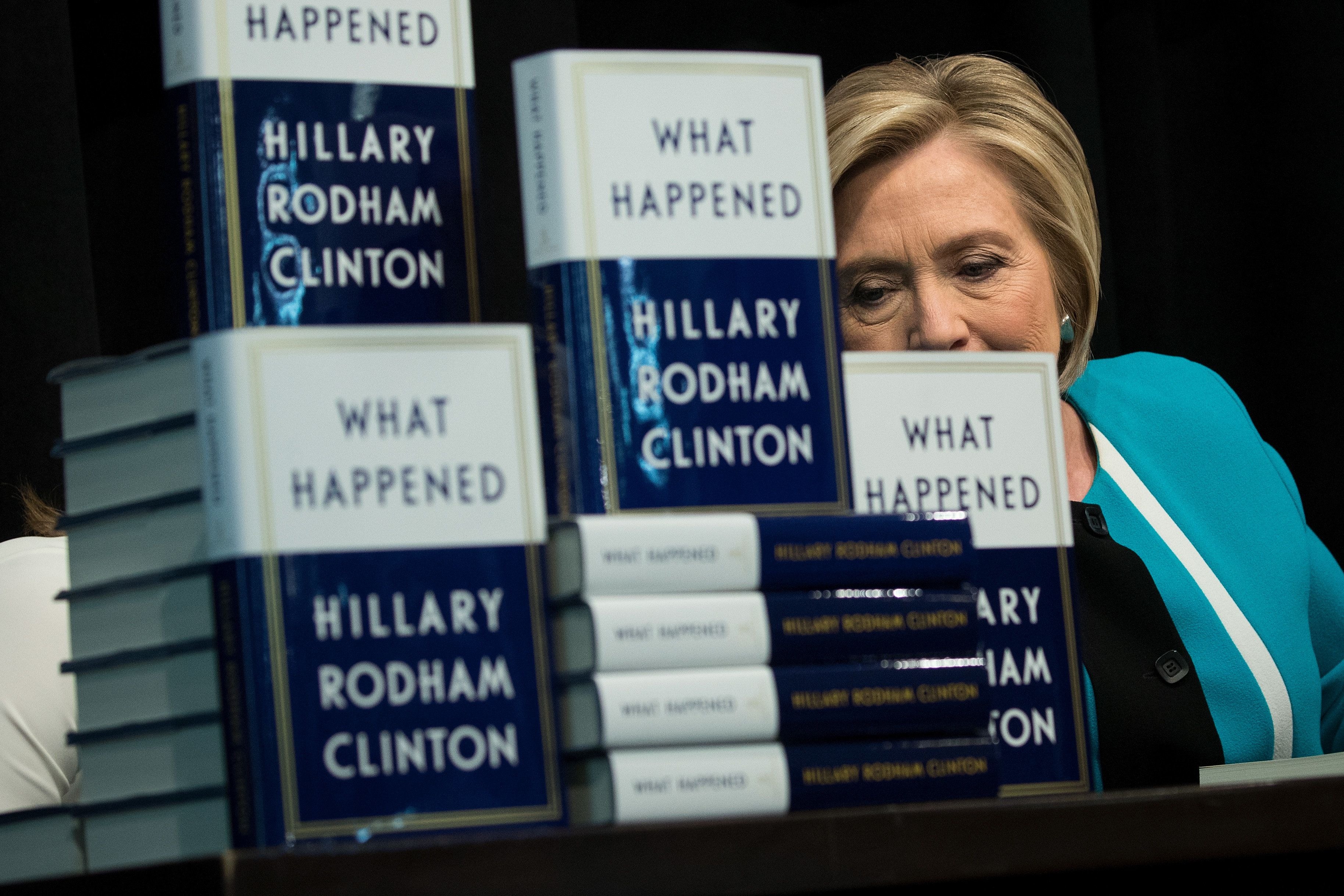 NEW YORK, NY - SEPTEMBER 12: Former U.S. Secretary of State Hillary Clinton signs copies of her new book 'What Happened' during a book signing event at Barnes and Noble bookstore September 12, 2017 in New York City. Clinton's book, which focuses on her 2016 election loss to President Donald Trump, goes on sale today. (Photo by Drew Angerer/Getty Images)
