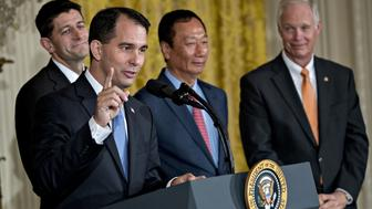 Scott Walker, governor of Wisconsin, second left, speaks as Senator Ron Johnson, a Republican from Wisconsin, from right, billionaire Terry Gou, chairman of Foxconn Technology Group, and U.S. House Speaker Paul Ryan, a Republican from Wisconsin, listen during an event in the East Room of the White House with U.S. House Speaker Paul Ryan, a Republican from Wisconsin, right, in Washington, D.C., U.S., on Wednesday, July 26, 2017. President Donald Trump announced that Foxconn plans a new factory in Wisconsin, fulfilling the Taiwanese manufacturing giants promise to invest in the U.S. Photographer: Andrew Harrer/Bloomberg via Getty Images
