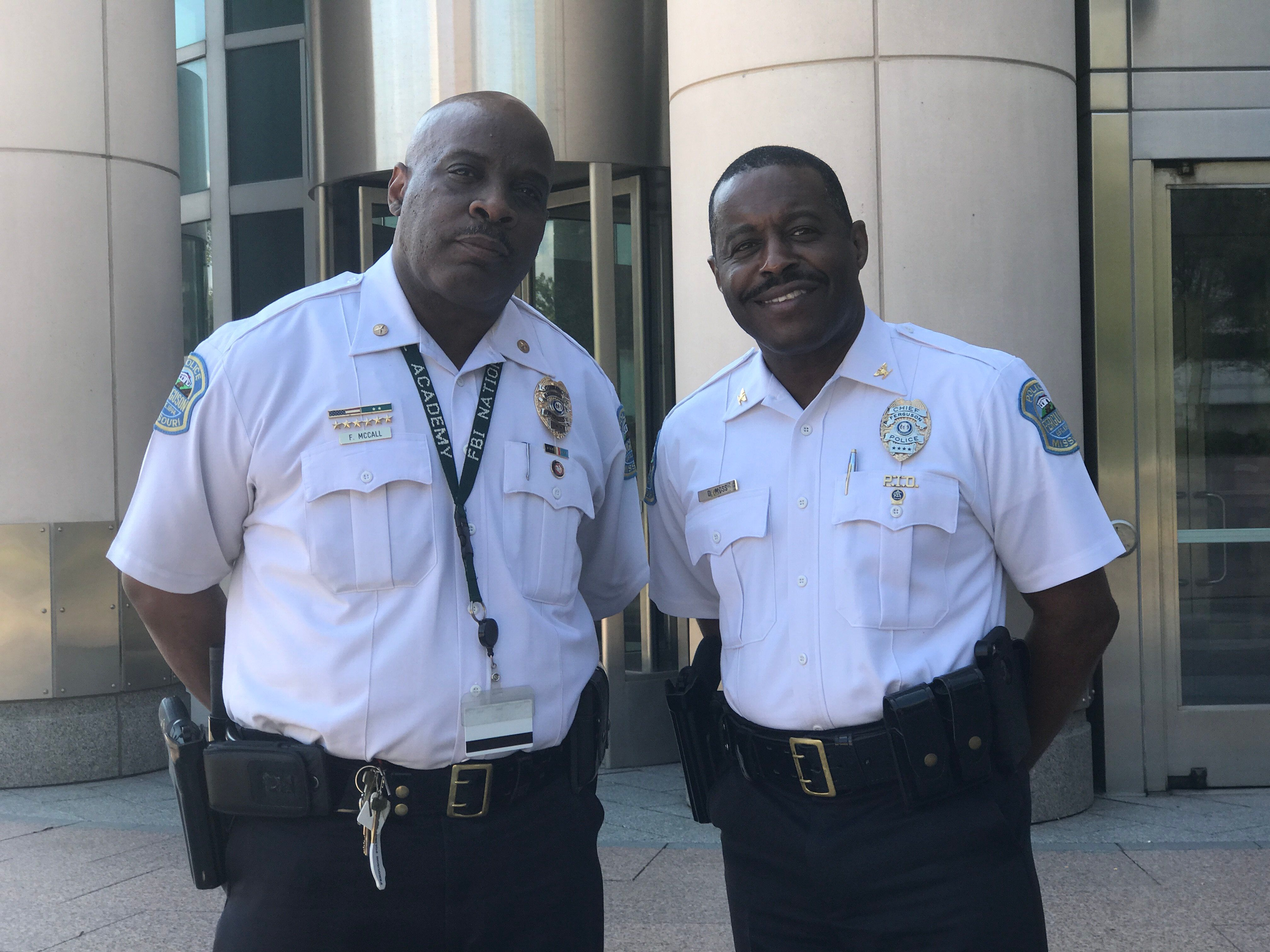 Ferguson Police Commander Frank McCall and Ferguson Police Chief Delrish Moss outside the federal courthouse in St Louis on Tuesday