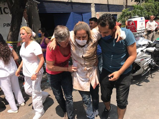 People help victims injured by the