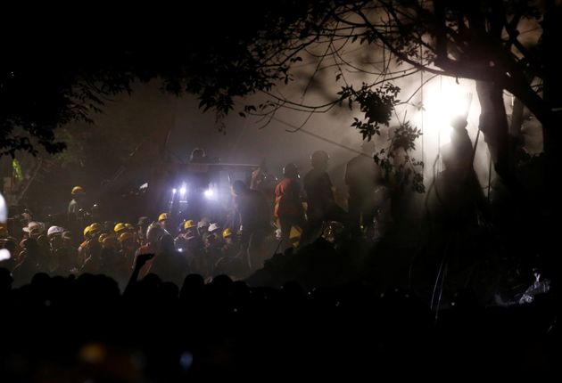 Rescuers had to work by torch light after power was cut in many areas of