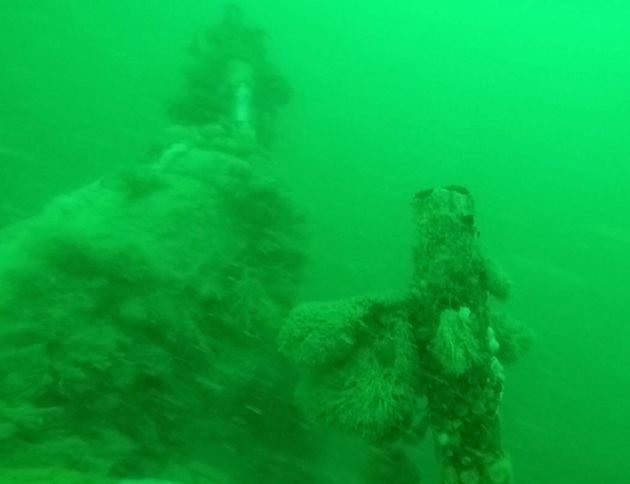 Damage indicatesthe sub may have struck a mine with its upper deck. Two torpedo tubes have been destroyed...