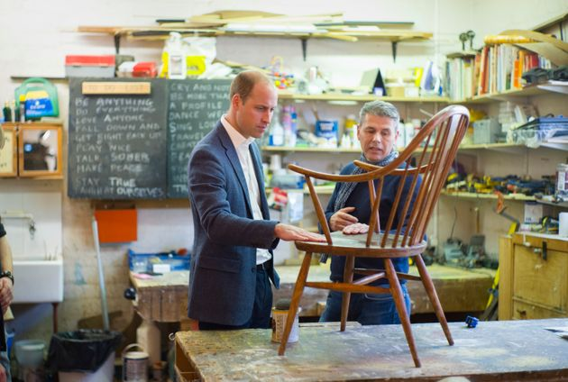 The Duke of Cambridge speaks with volunteer and former client Bernard Bristow during his visit to the...