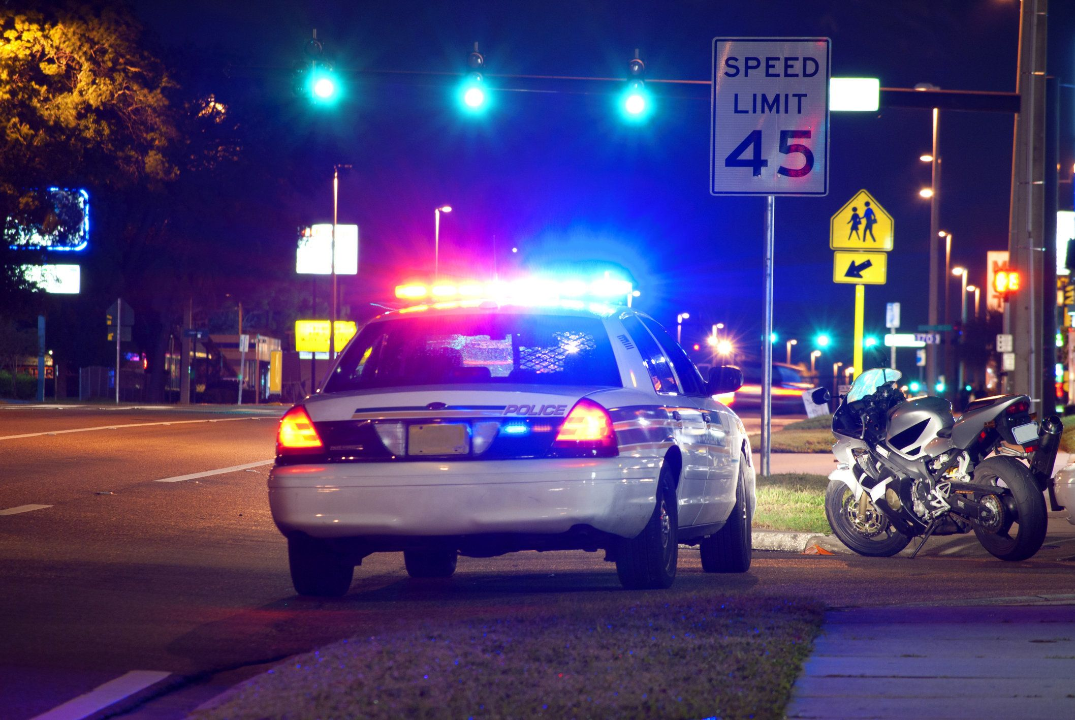 Motorcycle pulled over at night for a police traffic stop.