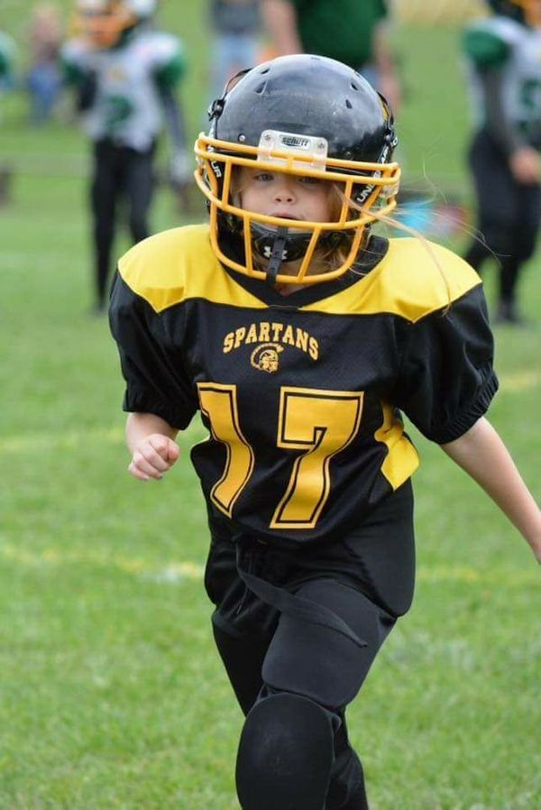 """""""My first-grader. The only girl on her Pop Warner team. She's my hero."""""""