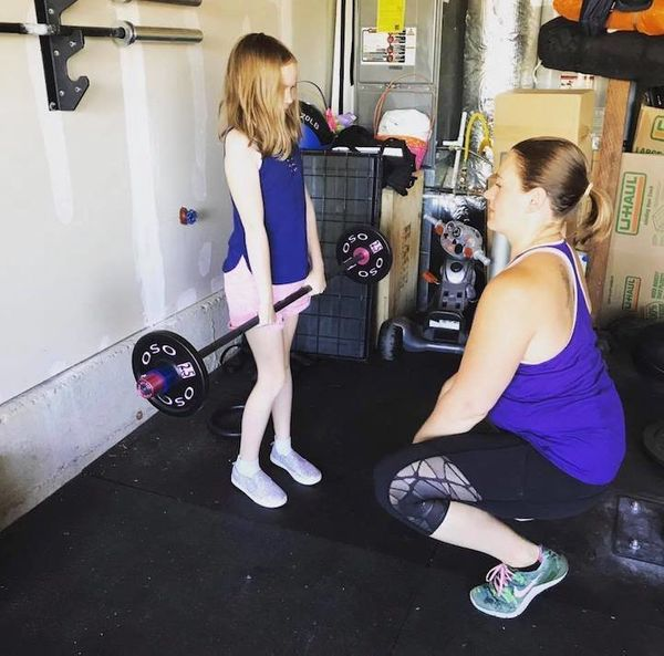"""""""I love coaching my 7-year-old daughter through lifting with her own child-sized barbell."""""""
