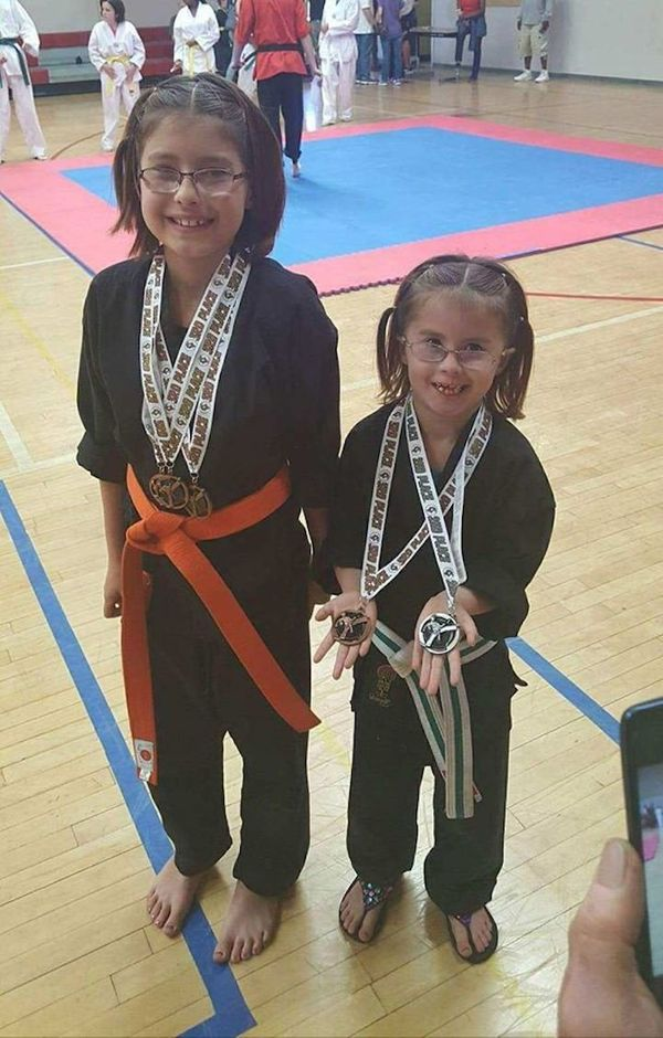 """""""My strong girls at their last karate tournament. My youngest leads her class and my oldest helps teach weapons. So proud of"""