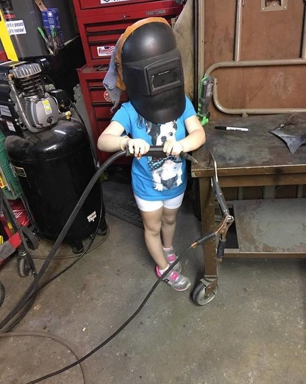 """""""Not actually welding in the picture itself, but she loves being out in the garage with her father (a mechanic) working on an"""