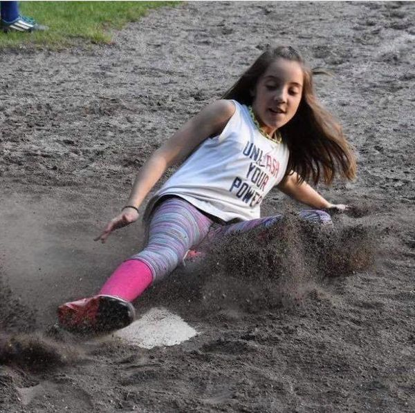 """""""Here's our 11-year-old daughter getting down and dirty during softball practice this year."""""""