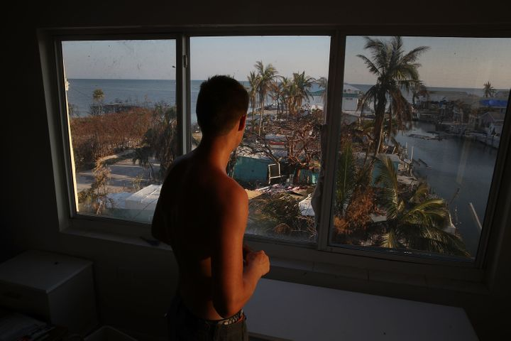 Markus Reinfandt looks out the window of his home onto the mobile homes that were destroyed by Hurricane Irma on Sept.18, 2017, in Marathon, Florida.
