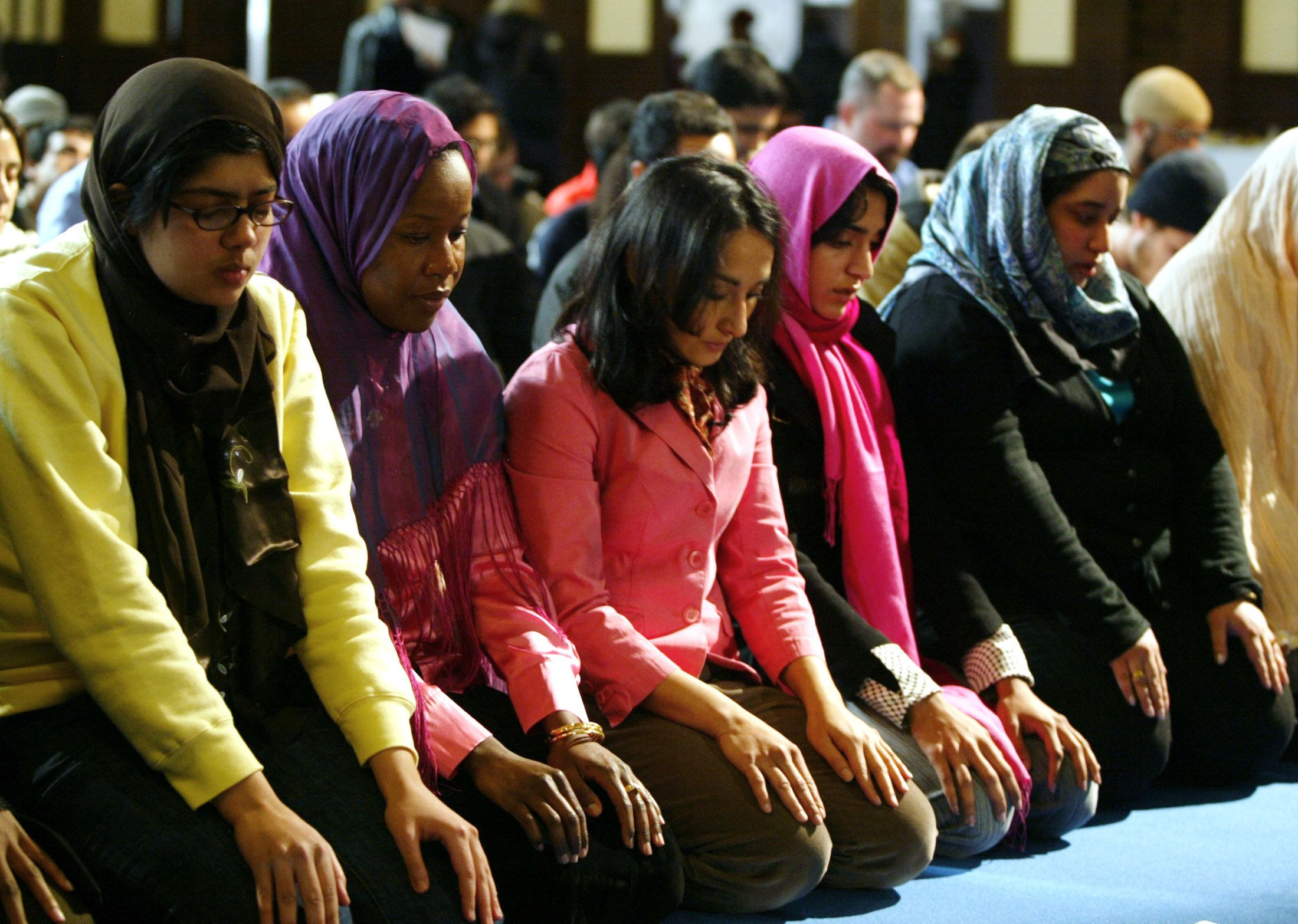 A group of women pray at the end of a public mixed-gender Muslim prayer service that was held in New York City, March 18, 200