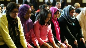 A group of women pray at the end of the first public mixed-gender Muslim prayer service that was held in New York City, March 18, 2005. The service was led by Dr. Amina Wadud, a professor of Islamic studies at Virginia Commonwealth University, at the Synod House in New York. REUTERS/Jeff Christensen  JC