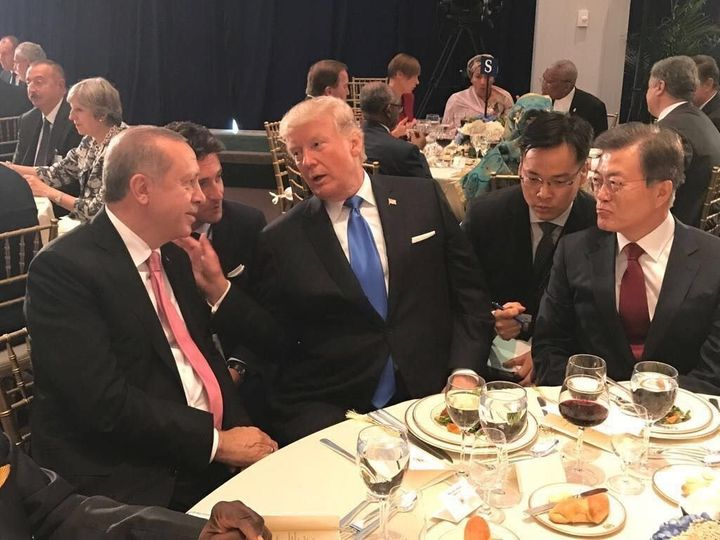 President of Turkey Recep Tayyip Erdogan L and US President Donald Trump 2 L chat each other during a dinner hosted by United