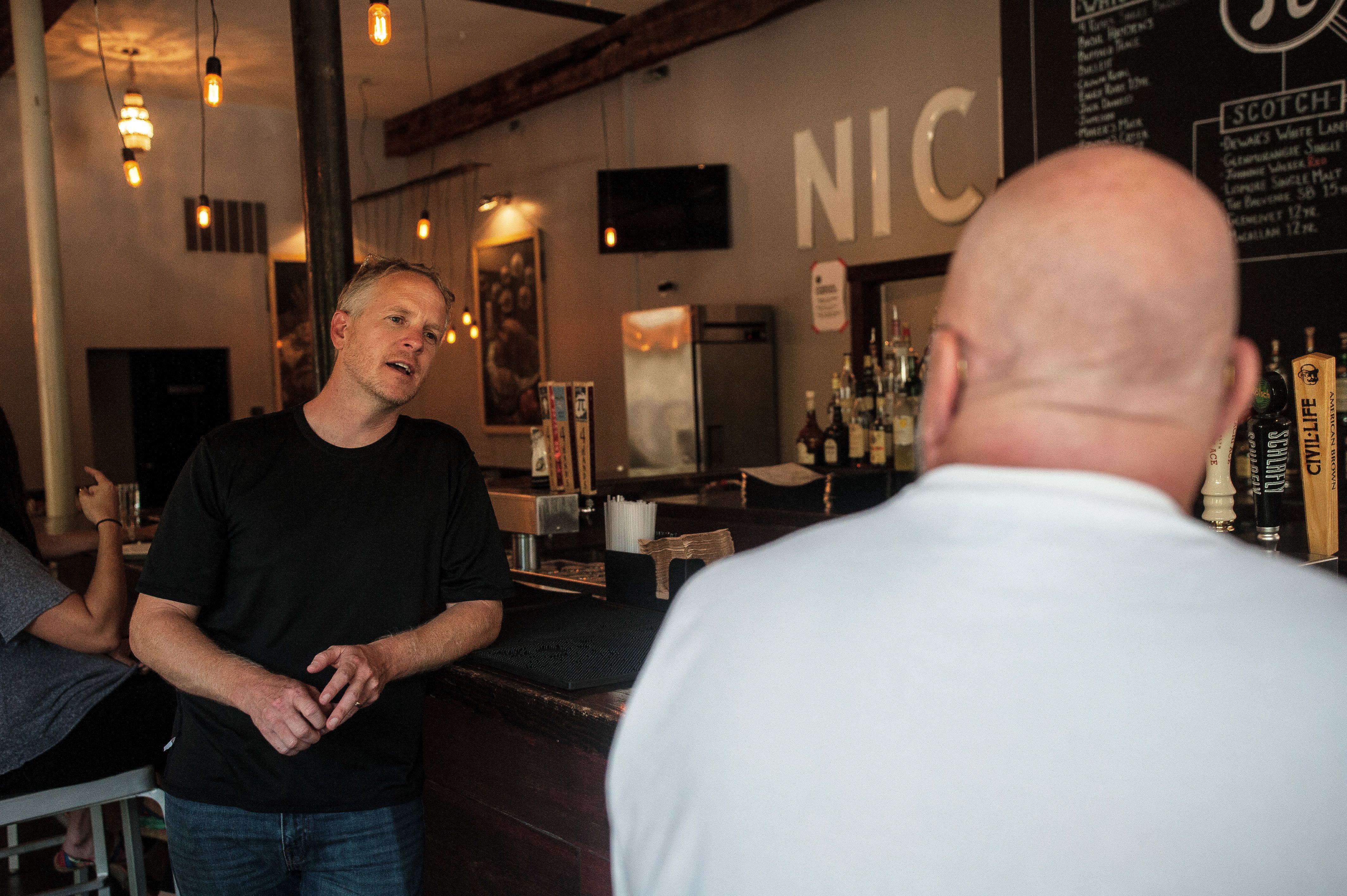 Chris Sommers, co-founder of Pi restaurants talks to supportive customers in their Central West End location in St Louis on Wednesday.